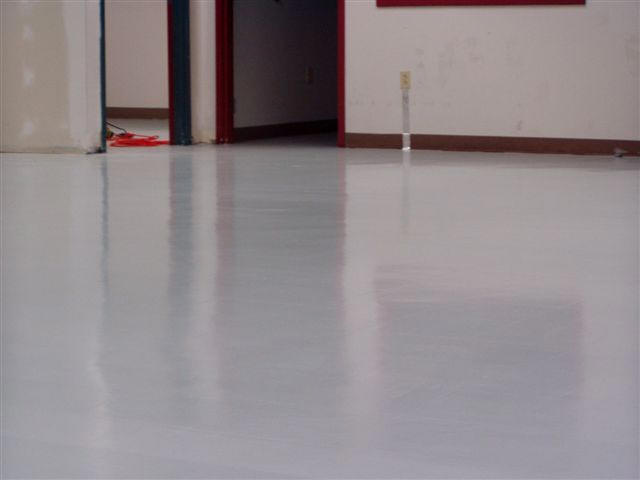 Conductive flooring installed over standard VCT tiles, saves ...